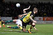 Burton Albion defender Kyle McFadzean (5) attempts the head the ball away from Brentford defender John Egan (14) during the EFL Sky Bet Championship match between Burton Albion and Brentford at the Pirelli Stadium, Burton upon Trent, England on 6 March 2018. Picture by Richard Holmes.