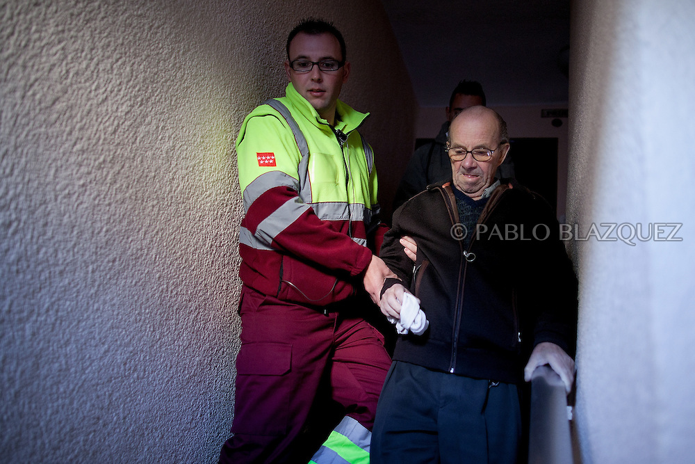 An ambulance driver picks up Vicente form his home take him hospital for medical checks after he went on surgery in Spanish Vicente Torres, 73, who is severely ill and underwent a recent heart surgery, and is waiting for a thrombus surgery faces an eviction from his house next April 18th after he endorsed his son, so Citibank would concede a credit to buy a house. His son already handed his house to the bank. Torres has lived at his home for the last 55 years and was paying it for 30 years. Eviction procedures in Spanish courts for unpaid mortgages and rent hit a record of 58,241 in 2011, a 21.2 percent rise over the previous year. Evictions have soared in Spain since the collapse of a property bubble in 2008 that triggered the country's economic crisis.