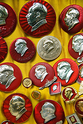 Detail of many communist era badges with head of Chairman Mao at Dongtai antique Market in Shanghai China