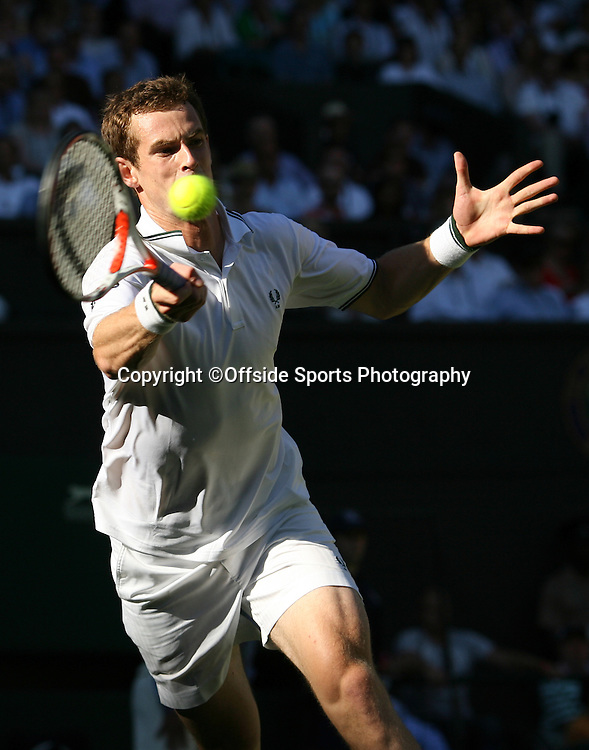 23/06/2009. The All England Lawn Tennis Championships. Andy Murray plays a forehand during his first round match against Robert Kendrick. Wimbledon, UK. Photo: Offside/Steve Bardens.