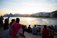 Sightseers watch the sun go down over Ipanema beach in Rio de Janeiro, Brazil. Picture by Andrew Tobin/Focus Images Ltd +44 7710 761829<br /> 27/06/2014
