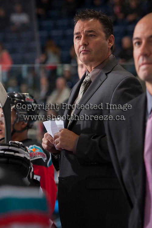 KELOWNA, CANADA - OCTOBER 5:   Dan Lambert, coach of the Kelowna Rockets stands on the bench opposite the Portland Winterhawks at the Kelowna Rockets on October 5, 2013 at Prospera Place in Kelowna, British Columbia, Canada (Photo by Marissa Baecker/Shoot the Breeze) *** Local Caption ***