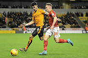 Nottingham Forest midfielder Ben Osborn tales on Wolverhampton Wanderers defender Danny Batth during the Sky Bet Championship match between Wolverhampton Wanderers and Nottingham Forest at Molineux, Wolverhampton, England on 11 December 2015. Photo by Alan Franklin.