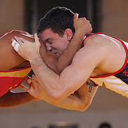 Keith Gavin, USA, (blue) in action against Ehsan Lashgari, Iran, (red) as wrestlers from USA, Iran and Russia compete at Grand Central Terminal as part of the Beat the Streets Gala. Billed ?The Rumble On The Rails,? the international wrestling event showcased competition as part of World Wrestling Month. Vanderbilt Hall, Grand Central Station, Manhattan,New York. USA. 15th May 2013. Photo Tim Clayton