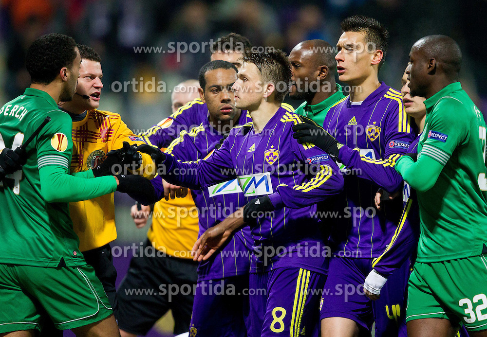 James Perch of Wigan Athletic arguing with Dejan Mezga #8 of Maribor during football match between NK Maribor and Wigan Athletic FC (ENG) in Round 6 of Group D of UEFA Europa League 2014, on December 12, 2013 in Stadion Ljudski vrt, Maribor, Slovenia. Maribor won against Wigan 2-1 and qualified to next Stage. Photo by Vid Ponikvar / Sportida