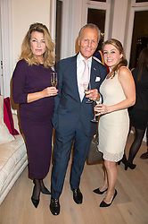 Left to right, RICHARD & ELIZABETH ELLIOT-SQUARE and MISS KATIE FULLER<br /> Personal Secretary to TRH Prince and Princess Michael of Kent at a reception to celebrate the publication of Quicksilver by HRH Princess Michael of Kent held at the home of Richard & Basia Briggs, 35 Sloane Gardens, London on 9th November 2015.