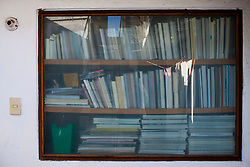 Bookshelves are seen through a window into the office of  Arquitectura 911Sc  in Mexico City.