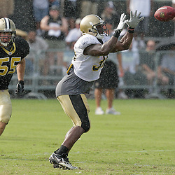 04 August 2009: New Orleans Saints running back Lynell Hamilton (30) prepares to make a catch in front of linebacker Dan Morgan (55) during an afternoon rain storm at New Orleans Saints training camp at the team's practice facility in Metairie, Louisiana.