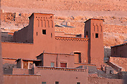 House with towers at Ksar Ait Ben Haddou, earthen fortified city, Ounila valley, Ouarzazate province, Morocco. The ksar is a group of earthen houses surrounded by high defensive walls with corner towers, in traditional pre-Saharan style.  The village stands above the Oued Marghen river in the High Atlas and was a stop on the caravan route from the Sahara to Marrakech. It was founded in the 17th century and has been a UNESCO World Heritage Site since 1987. Picture by Manuel Cohen