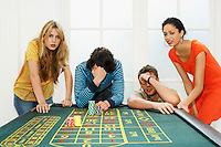 Group of friends losing on roulette table