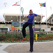 March 1, 2014, Palm Springs, California: <br /> A man on stilts poses for a photograph during Kids Day at the Indian Wells Tennis Garden sponsored by the Coachella Valley National Junior Tennis and Learning Network.<br /> (Photo by Billie Weiss/BNP Paribas Open)
