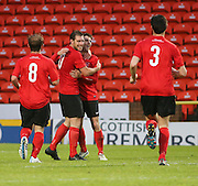 Gary Sutheland (second left) is congratulated after firing Tayport into a 3-0 lead as Tayport (red) beat North End (white) 4-1 in the GA Engineering Cup Final at Tannadice<br /> <br />  - &copy; David Young - www.davidyoungphoto.co.uk - email: davidyoungphoto@gmail.com