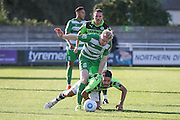 Forest Green Rovers midfielder Fabien Robert (26) is sent sprawling during the Vanarama National League match between North Ferriby United and Forest Green Rovers at Eon Visual Media Stadium, North Ferriby, United Kingdom on 8 October 2016. Photo by Simon Davies.