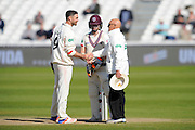 Match drawn - Lancashire's James Anderson with Somerset's Chris Rogers shakes hands with one of the umpires to end the Specsavers County Champ Div 1 match between Somerset County Cricket Club and Lancashire County Cricket Club at the County Ground, Taunton, United Kingdom on 4 May 2016. Photo by Graham Hunt.