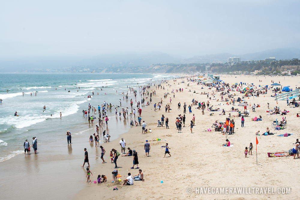 People enjoy the warm summer weather at Santa Monica beach in west Los Angeles, California.