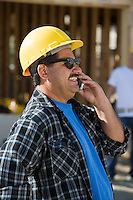 Worker using mobile phone in construction site