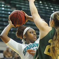 UNCW's Ryan Flowers looks to pass around William and Mary's Abby Rendle Sunday January 4, 2015 at Trask Coliseum on the campus of UNCW. (Jason A. Frizzelle)