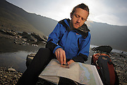 Navigation on Helvellyn, Lake District, with outdoor journalist, Carey Davies. Shot for TGO magazine.