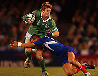 Photograph: Jack Atley.<br />Ireland v France. 09/11/2003.<br />Rugby World Cup. Quarter Final match. Melbourne, Australia.<br />PIC SHOWS: Ireland's Brian O'Driscoll is tackled by French player Frederic Michalak. France defeated Ireland by 43 points to 21.