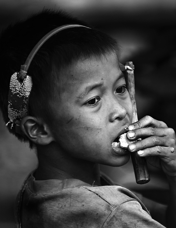 A boy with his catapult near Pak Beng, Laos.