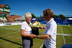 LIVERPOOL, ENGLAND - Sunday, June 24, 2018: Tournament director Anders Borg presents flowers to Liverpool Cricket Club volunteer Pam Langford during day four of the Williams BMW Liverpool International Tennis Tournament 2018 at Aigburth Cricket Club. (Pic by Paul Greenwood/Propaganda)