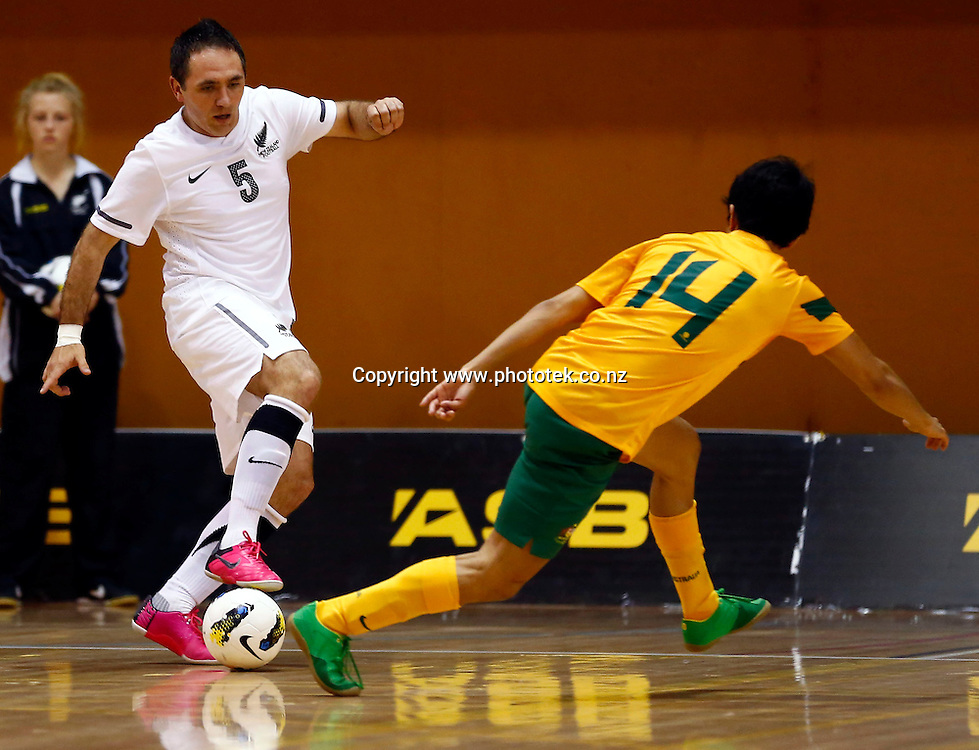 Futsal Whites Miroslav Major gets the edge on Futsal Roos Rengai David Ingram.  ASB Trans Tasman Cup, Futsal Whites v Futsal Roos, ASB Stadium, Kohimarama, Friday 21st September 2012. Photo: Shane Wenzlick