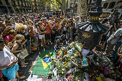 August 18, 2017 - Barcelona, Catalonia, Spain - People gather around makeshift memorial at Canaletas Fountains in Las Ramblas where a van ploughed through the crowds during a 550 meter long jihadist terror trip. Thirteen people were killed and almost 80 wounded, 15 seriously, when the van tore through the crowd (Credit Image: © Matthias Oesterle via ZUMA Wire)
