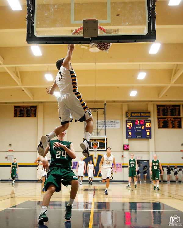 Milpitas guard Christian Rita (3) dunks the ball during a fast break against Palo Alto at Milpitas High School in Milpitas, California, on January 31, 2014.  Milpitas beat Palo Alto 51-39. (Stan Olszewski/SOSKIphoto)