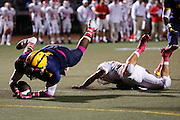 Milpitas' Savion Black (1) dives into the end zone for a touchdown during homecoming against Saratoga at Milpitas High School in Milpitas, California, on October 11, 2013.  Milpitas beat Saratoga 54-14. (Stan Olszewski/SOSKIphoto)