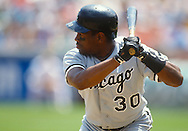 CHICAGO - UNDATED:  Tim Raines of the Chicago White Sox bats during an MLB game at the Oakland-Alameda County Coliseum versus the Oakland Athletics.  Raines played for the White Sox from 1991-1995. (Photo by Ron Vesely)  Subject:  Tim Raines