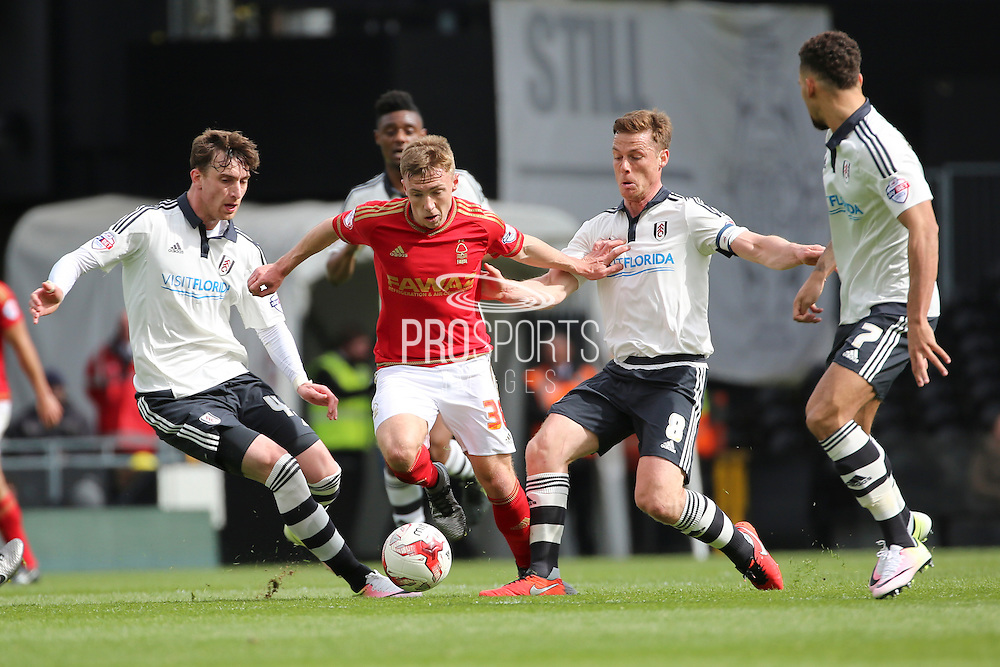 Nottingham Forest midfielder Ben Osborn (38) dribbling through a crowd of Fulham players during the Sky Bet Championship match between Fulham and Nottingham Forest at Craven Cottage, London, England on 23 April 2016. Photo by Matthew Redman.