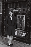 Teenager boy mimics poster outside Liberty on Regent Street, London, UK, 1983