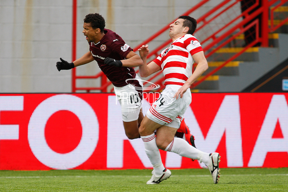 Hearts FC Forward Osman Sow taking another bad tackle during the Ladbrokes Scottish Premiership match between Hamilton Academical FC and Heart of Midlothian at New Douglas Park, Hamilton, Scotland on 24 January 2016. Photo by Craig McAllister.