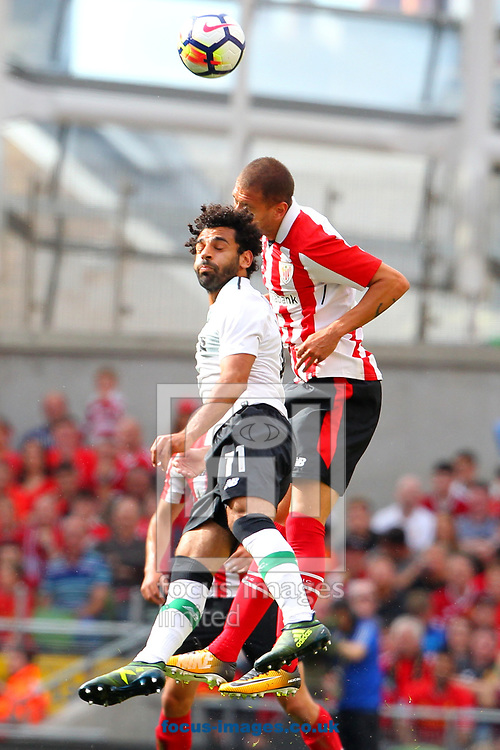 Mohamed Salah of Liverpool and Enric Boveda of Athletic Bilbao during the Pre-season Friendly match at the Aviva Stadium, Dublin<br /> Picture by Yannis Halas/Focus Images Ltd +353 8725 82019<br /> 05/08/2017