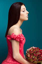 Young Woman in Pink Dress Holding Flower Bouquet