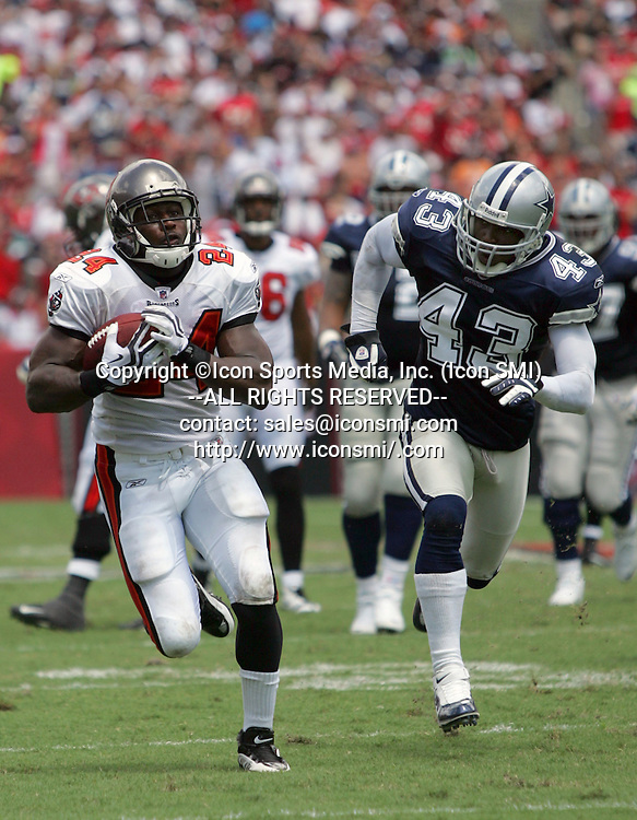 13 SEP 2009: Carnell Cadillac Williams (24) of the Buccaneers out runs Cowboy Gerald Sensabaugh (43) during the game between the Dallas Cowboys and the Tampa Bay Buccaneers at Raymond James Stadium in Tampa, Florida.