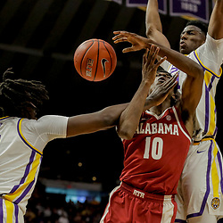 Jan 8, 2019; Baton Rouge, LA, USA; Alabama Crimson Tide guard Herbert Jones (10) is defended by LSU Tigers forward Naz Reid (0) and guard Skylar Mays (4) during the first half at the Maravich Assembly Center. Mandatory Credit: Derick E. Hingle-USA TODAY Sports