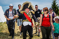 20150614 Ligny Belgium. The Battle of Ligny (16 June 1815) was the last victory of the military career of Napoleon I.Today it was re-enacted by 1500 people just a few days before the 200th birth day of Napoleon's final loss at Waterloo.High ranked marichal interacts enthousiastic with the tourists.
