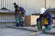 Local employees welding at the port in Mtwara...Mtwara is under going a lot of growth due in part to the investment of oil companies in the area...VSO is working in partnership with BG group and VETA, a local vocational training centre, to help train local people so as they can find employment.