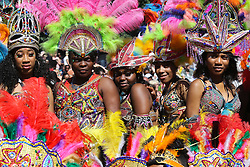 © Licensed to London News Pictures. 29/08/2016. Leeds, UK. Women dressed in a brightly coloured feathered headdresses at the Leeds West Indian Carnival in Leeds, West Yorkshire. First run in the 1960's, the Leeds West Indian Carnival is Europe's longest running authentic Caribbean carnival parade. Photo credit : Ian Hinchliffe/LNP