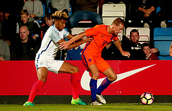 Lloyd Kelly of England Under 20s challenges Dani De Wit of Netherlands Under 20s - Mandatory by-line: Robbie Stephenson/JMP - 31/08/2017 - FOOTBALL - Telford AFC - Telford, United Kingdom - England v The Netherlands - International Friendly