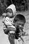 A young boy threaten me with a toy gun.