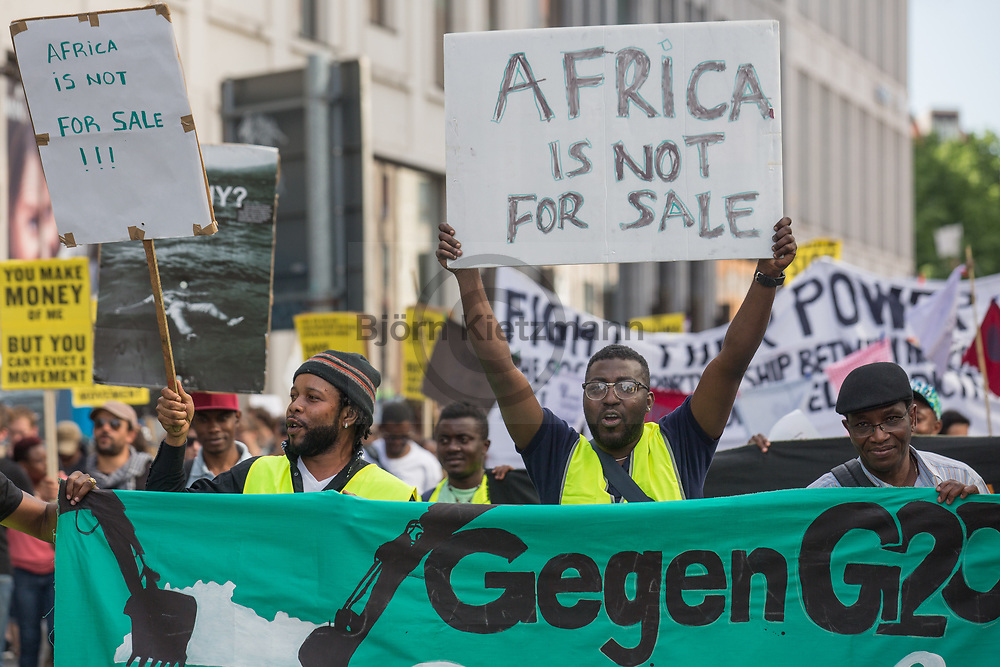 Berlin, Germany - 10.06.2017<br /> <br /> Anti-G20 Demonstration under the slogan &rdquo;they call it partnership, we call it hell&rdquo; against the upcoming G20-Africa conference.<br /> <br /> Anti-G20 Demonstration unter dem Motto &rdquo;They call it partnership, we call it hell&rdquo; (&rdquo;Sie nennen es Partnerschaft, wir nennen es Hoelle&quot;) gegen die bevorstehende G20-Afrika Konferenz.<br /> <br /> Photo: Bjoern Kietzmann