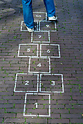 adult person playing hopscotch