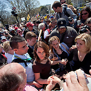 Rep. Michele Bachmann (R-MN) makes her way through a crowd of supporters at a Tea Party rally on Capitol Hill on Wednesday, April 6, 2011 in Washington.