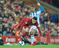 LIVERPOOL, ENGLAND - Friday, April 26, 2019: Liverpool's Alex Oxlade-Chamberlain (L) gets away from Huddersfield Town's Juninho Bacuna during the FA Premier League match between Liverpool FC and Huddersfield Town AFC at Anfield. (Pic by David Rawcliffe/Propaganda)