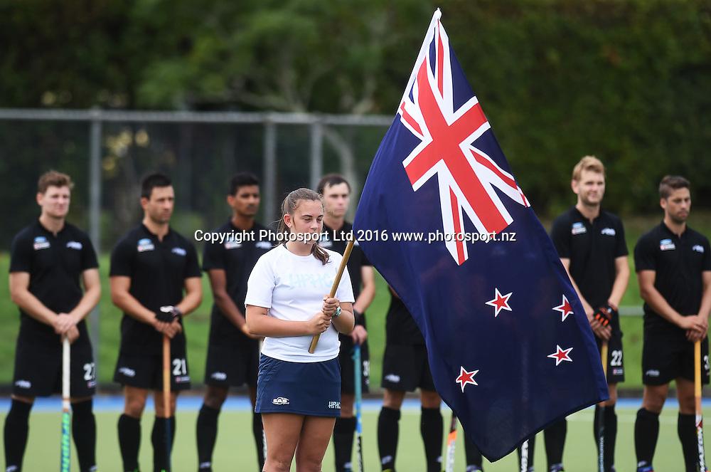 The NZ flag bearer during the national anthem. Black Sticks Men vs Korea test match series, Lloyd Elsmore Hockey Stadium, Auckland, New Zealand. Saturday 19 March 2016. Photo: Andrew Coranga / www.photosport.nz