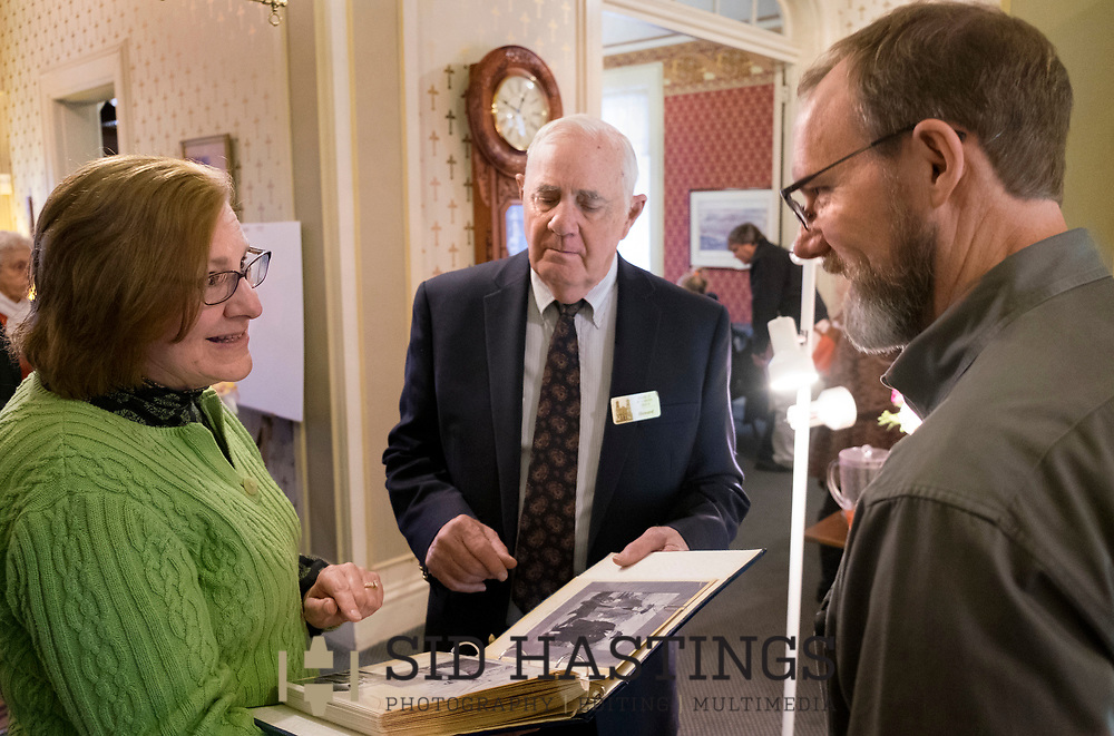 11 MARCH 2018 -- ST. LOUIS -- Carol Bullman (left) and Dave Niehaus (right), descendants of German immigrant Ignatius Strecker, talk with Howard Matthews after Mass at the Shrine of St. Joseph Sunday, March 11, 2018 in the Columbus Square neighborhood of St. Louis. Bullman, Niehaus and other Strecker descendants gathered to remember the healing of the Strecker, thought mortally ill, during an 1864 service honoring Jesuit priest Peter Claver, a missionary who worked among slaves in South America during the 17th century. Strecker's healing was among the miracles attributed to Claver that led to his 1888 canonization by Pope Leo XIII. Photo © copyright 2018 Sid Hastings.