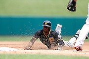 ST. LOUIS, MO - AUGUST 15: Starling Marte #6 of the Pittsburgh Pirates slides into third base with a triple against the St. Louis Cardinals during the game at Busch Stadium on August 15, 2013 in St. Louis, Missouri. (Photo by Joe Robbins)