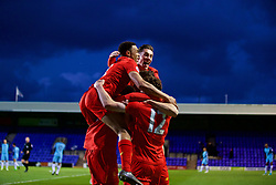BIRKENHEAD, ENGLAND - Monday, April 24, 2017: Liverpool's Matthew Virtue celebrates scoring the third goal against Manchester City with team-mates Trent Alexander-Arnold and captain Harry Wilson during the Under-23 FA Premier League 2 Division 1 match at Prenton Park. (Pic by David Rawcliffe/Propaganda)